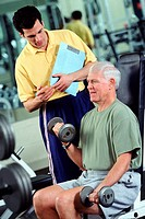 Senior man working out with free weights