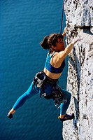 Rock Climber Reaching for a Hold