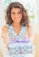 Smiling woman giving present