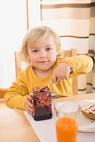 Girl having breakfast, smiling, portrait (thumbnail)