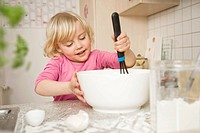 Girl mixing ingredients in bowl (thumbnail)