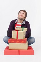 Mid adult man with Christmas gifts, smiling