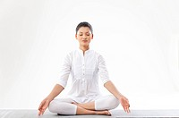 Woman meditating over white background
