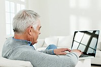 Germany, Berlin, Senior man using laptop