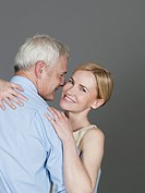 Mature couple embracing each other, smiling