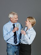 Mature couple drinking sparkling wine, smiling