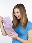 Young woman with letter, smiling