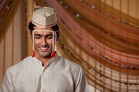 Young Indian groom smiling