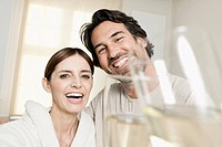 Germany, Berlin, Mature couple in bathroom with sparkling wine