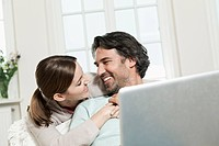 Germany, Berlin, Mature couple using laptop
