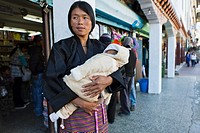 Bhutanese woman with baby in the center town, Thimphu, Bhutan, Asia.