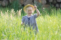 Germany, Bavaria, Girl standing in meadow, smiling, portrait