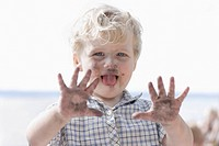 Germany, Bavaria, Boy playing with charcoal, smiling (thumbnail)
