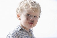 Germany, Bavaria, Boy with charcoal on his face, close up (thumbnail)