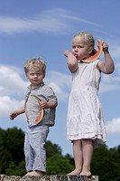 Germany, Bavaria, Girl and boy eating watermelon