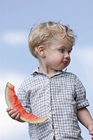 Germany, Bavaria, Boy eating watermelon, close up