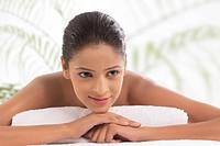 Close_up of beautiful woman at spa