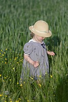 Germany, Bavaria, Girl walking through spring meadow
