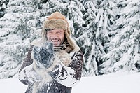 Austria, Salzburg County, Mature man having fun in snow, smiling