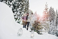 Austria, Salzburg County, Couple celebrating christmas in snowy landscape