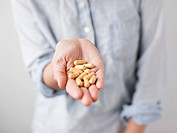 Woman showing handful of pills
