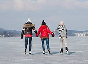 Austria, Teenage girls doing ice skating