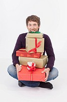 Mid adult man with Christmas Gifts, smiling, portrait
