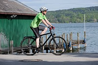 Germany, Bavaria, Starnberg, Mature man cycling by pier