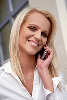 Businesswoman having a break, talking on her mobile phone.