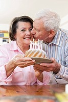 Germany, Leipzig, Senior man and woman celebrating birthday