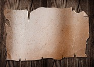 Old paper sheet on a wooden surface