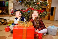 Children waiting for opening presents.