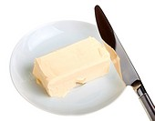 piece of butter on a saucer and knife