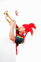 jester - entertaining figure in typical costume blowing trumpet