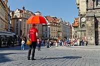 Tour guide waiting for customers on Staromestske Namesti square in Stare Mesto quarter, Prague, Czech Republic, Europe