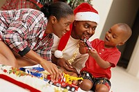 Parents and Son Playing with Christmas Gifts