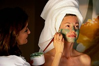 Applying Seaweed Mask to Woman´s Face