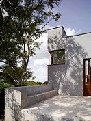 The Gray House is a new family dwelling in Howth that sits into slopped ground at the end of an existing back garden overlooking