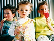 Three children with ice lollies