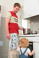 Father and Baby Son in Kitchen
