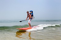 father and son stand up paddling
