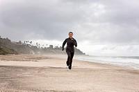 teenager running on the beach