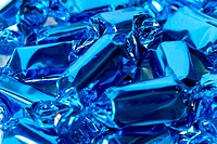 Detail of hard candies wrapped in blue foil