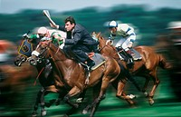 Businessman riding racehorse in race
