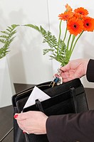Woman taking key ring from handbag