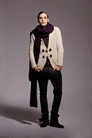 Young man wearing cardigan and scarf