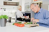 Senior couple preparing healthy meal in kitchen (thumbnail)