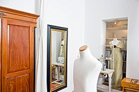Dressmaker's model in a tailor studio