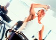 Man exercising at health club
