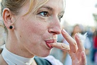 Woman with cotton candy on the Oktoberfest in Munich, Bavaria, Germany